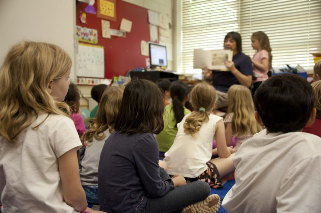 teacher reading to class of students